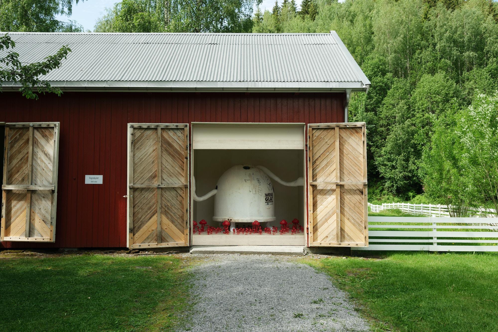 Installation, red house, glass window, art-sculptures.